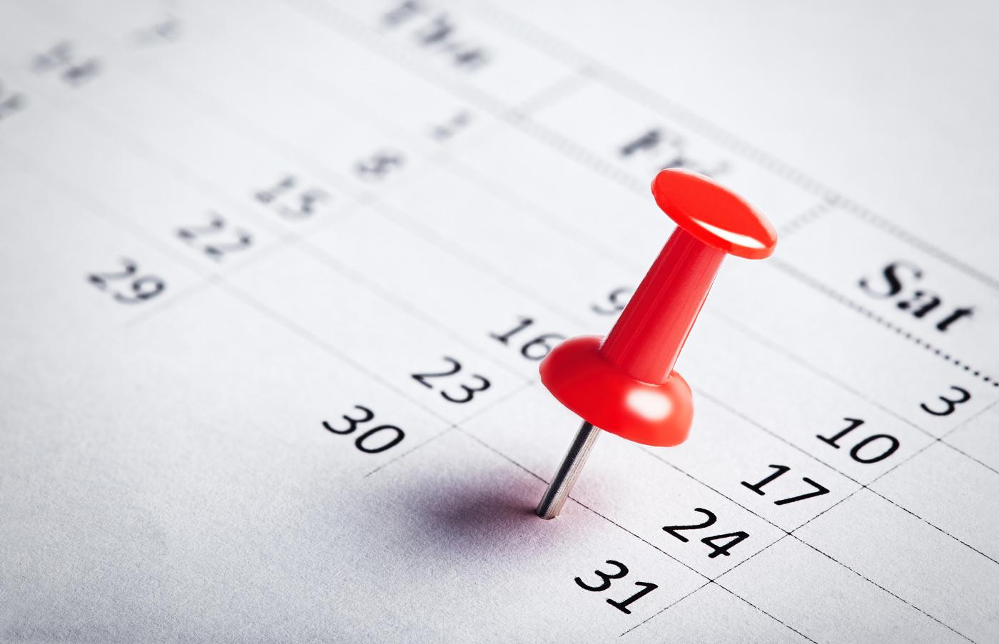 Pushpin on important date on calendar