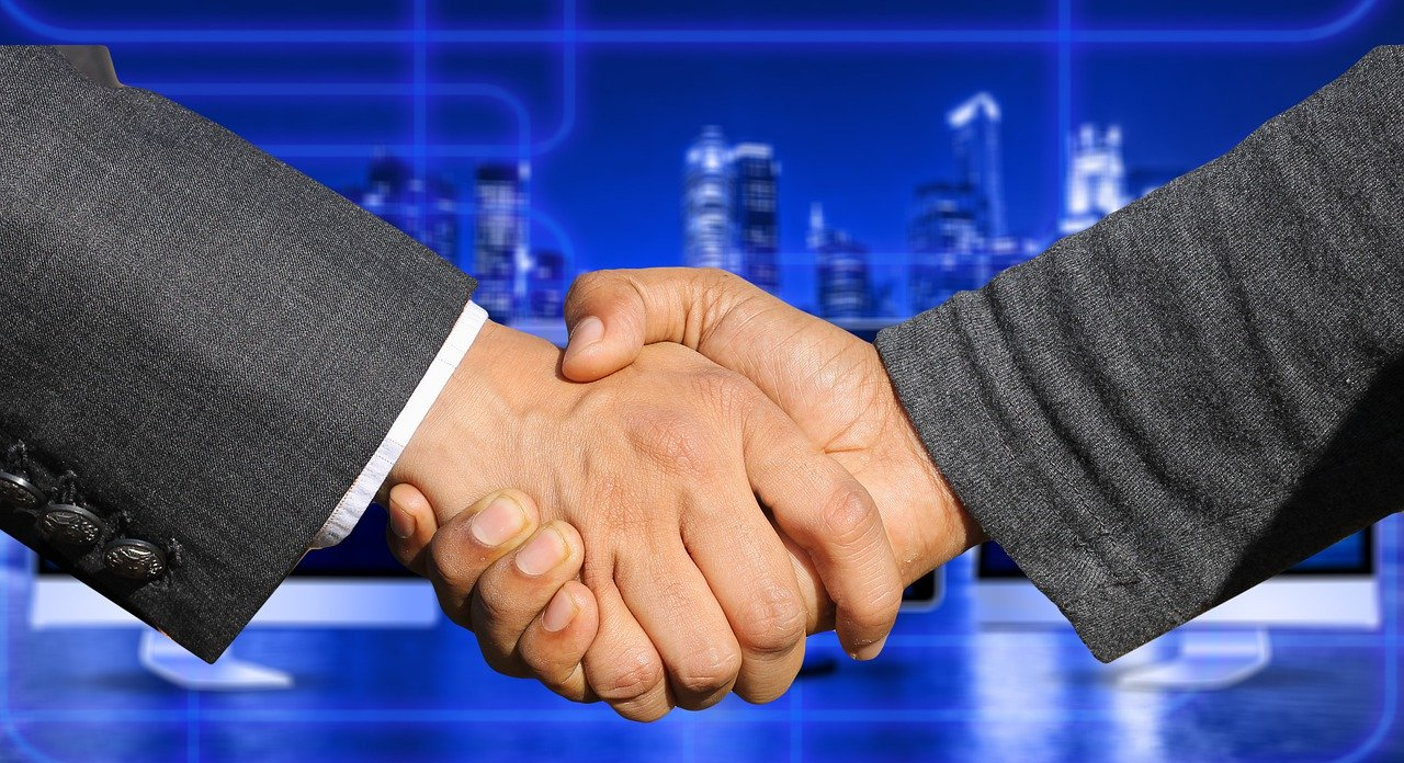 Businessmen handshake merger acquisition