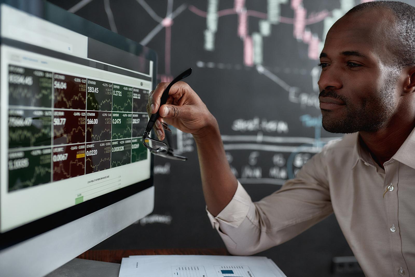 Trader analyzing stock charts