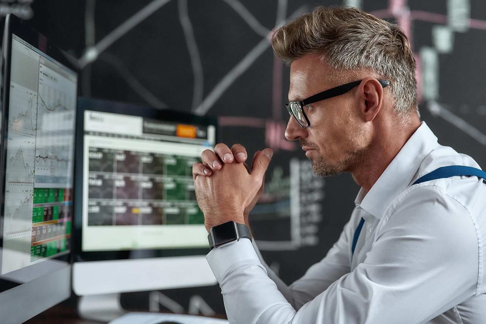 Trader reviewing trading charts