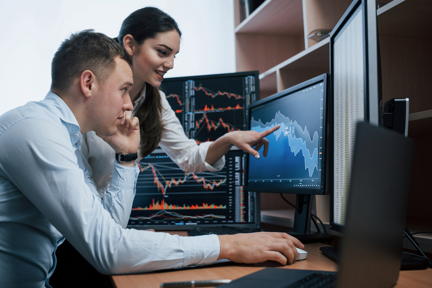 Trader reviewing stock charts, stock price action, learning to trade