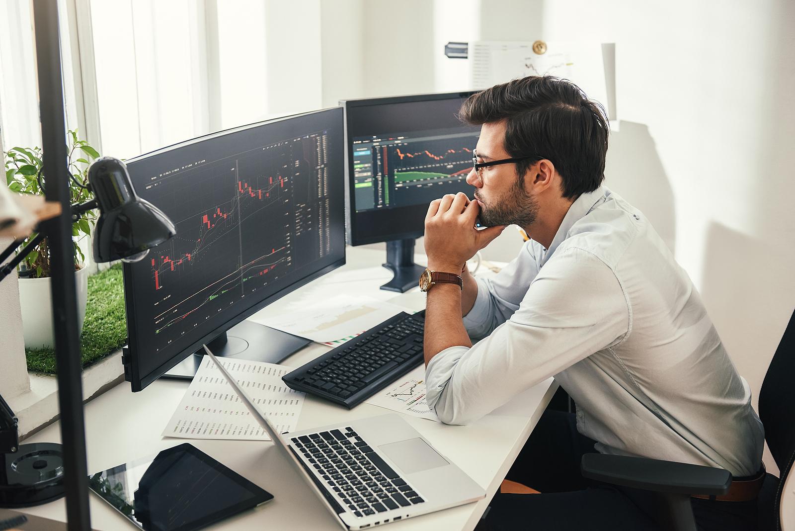 Trader watching trading screens