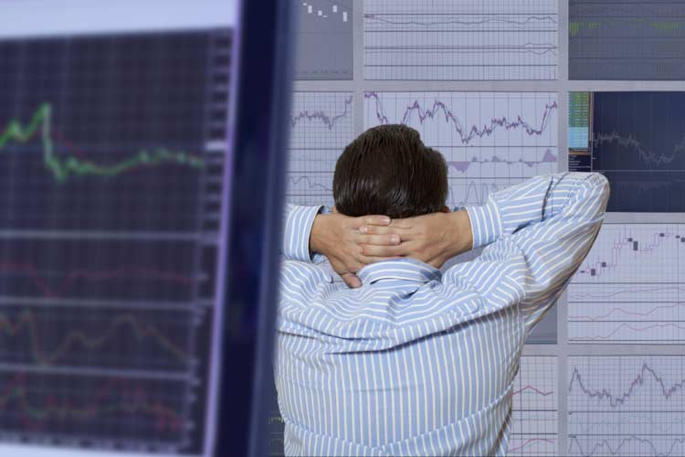 Tense options trader watching market