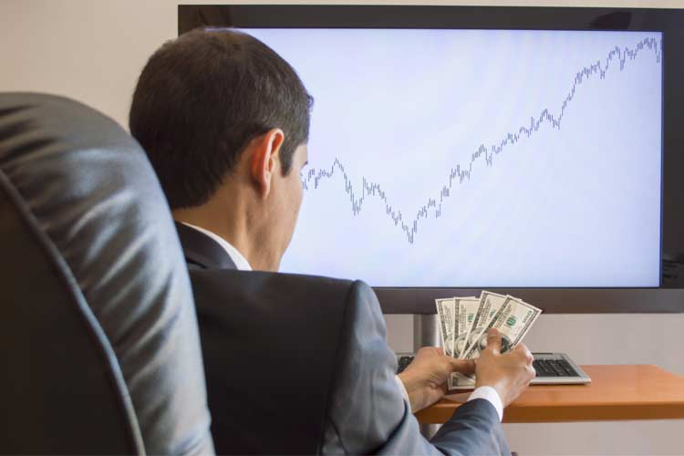 Options trader counting his cash